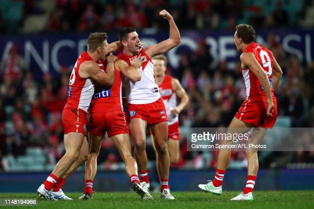 Colin O'Riordan of the Swans celebrates kicking a goal during the round eight AFL match between the Sydney Swans and the Essendon Bombers at Sydney...