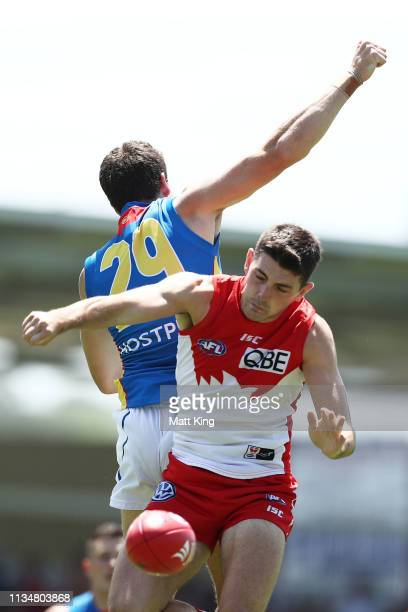 Colin O'Riordan of the Swans competes for the ball against Chris Burgess of the Suns during the 2019 JLT Community Series AFL match between the...