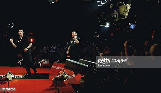 Colin Osborne of England celebrates a point against Andy Jenkins of England during the quarterfinals of the Ladbrokes World Darts Championship at The...