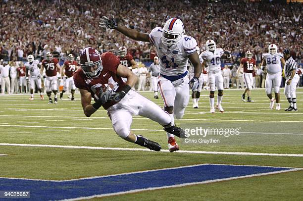 Colin Peek of the Alabama Crimson Tide catches a 17yard touchdown reception in the third quarter against Ryan Stamper of the Florida Gators during...