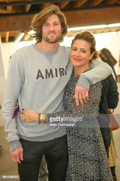 Colin Peeks and Jen Disisto pose for a photo at OptiMystic A Brandon Boyd Pop Up Gallery Featuring He Tasya Van Ree Natalie Bergman Diana Garcia And...