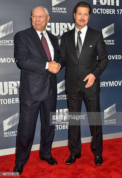 Colin Powell and Brad Pitt pose for photographers on the red carpet during the The Fury Washington DC premiere at The Newseum on October 15 2014 in...
