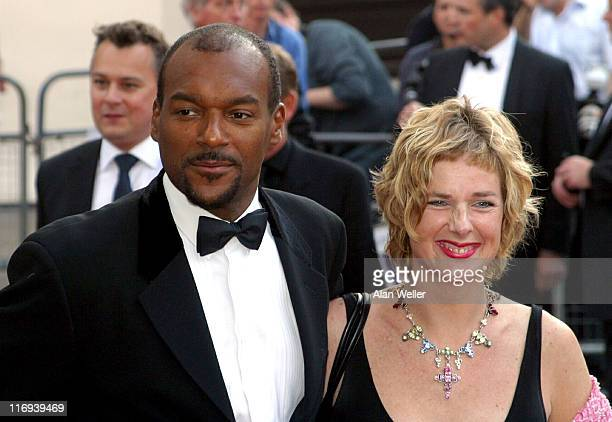 Colin Salmon and guest during The Royal Gala Charity Performance of 'Mamma Mia' at Prince of Wales Theatre in London Great Britain
