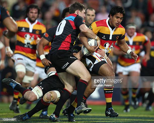 Colin Slade of Canterbury tackles Trent Renata of Waikato during the round 13 ITM Cup match between Waikato and Canterbury at Waikato Stadium on...