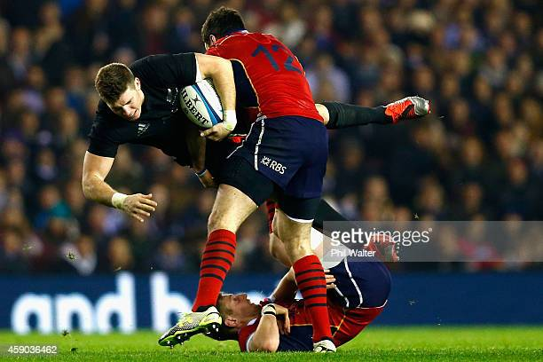 Colin Slade of the All Blacks is tackled by Alex Dunbar of Scotland during the Viagogo Autumn International match between Scotland and New Zealand at...