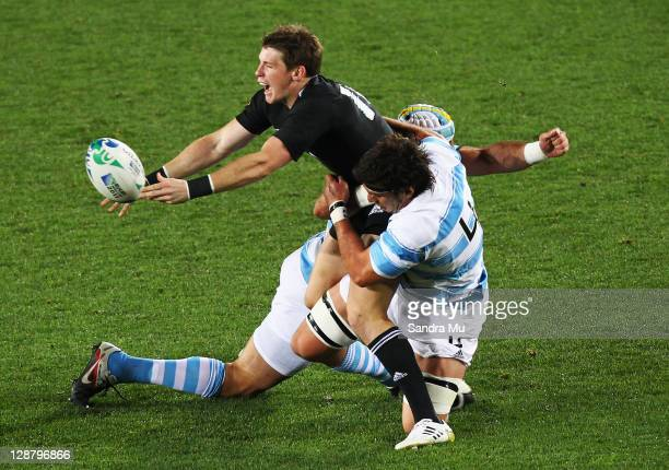 Colin Slade of the All Blacks is tackled by Manuel Carizza of Argentina shortly before being substituted during quarter final four of the 2011 IRB...