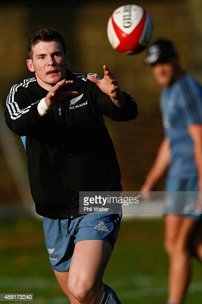 Colin Slade of the All Blacks takes a pass during the New Zealand All Blacks training session at Sophia Gardens on November 18, 2014 in Cardiff,...