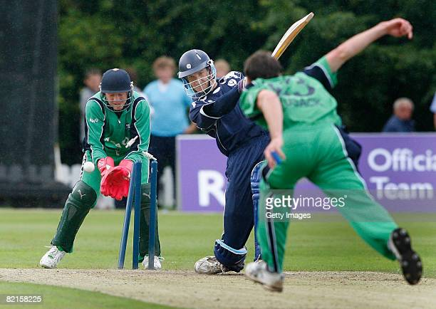 Colin Smith of Scotland is bowled out by Alex Cusack of Ireland as wicket keeper Niall O'Brien of Ireland looks on during ICC World Twenty20 Cup...