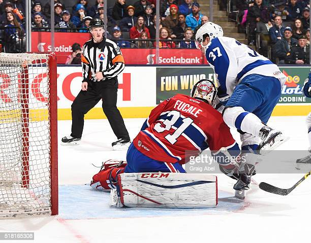 Colin Smith of the Toronto Marlies puts one by Zachary Fucale of the St John's IceCaps during game action on March 26 2016 at Air Canada Centre in...