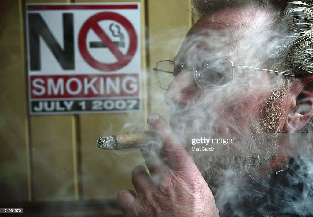 smoking ban comes into effect in england photos and images getty  colin stacey smokes in the saracens head public house in bath on 30 2007