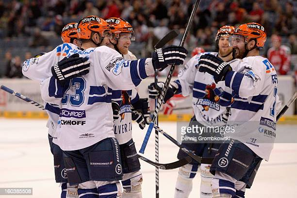 Colin Stuart of Iserlohn celebrates with teammates during the DEL match between Koelner Haie and Iserlohn Roosters at Lanxess Arena on January 30...
