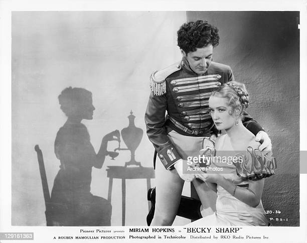 Colin Tapley puts his arms around Miriam Hopkins in a scene from the film 'Becky Sharp' 1935