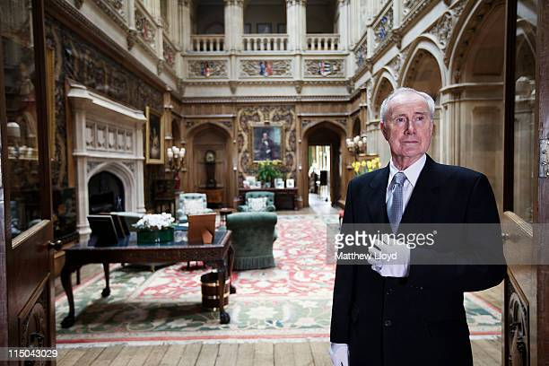 Colin the butler poses in the saloon at Highclere Castle on March 15, 2011 in Newbury, England. Highclere Castle has been the ancestral home of the...