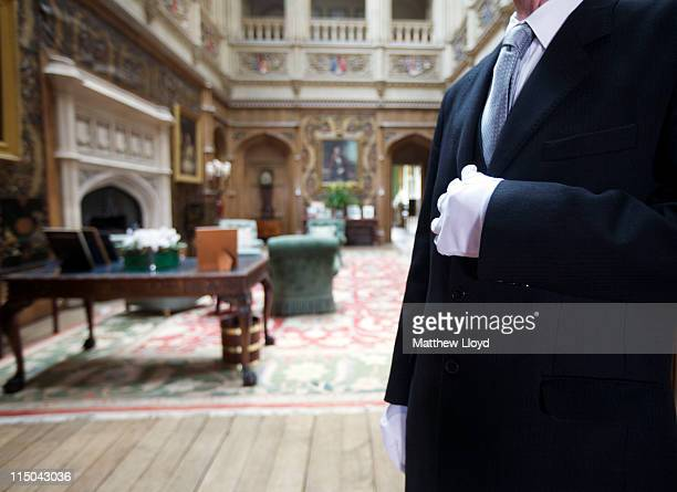 Colin the butler poses in the saloon at Highclere Castle on March 15 2011 in Newbury England Highclere Castle has been the ancestral home of the...