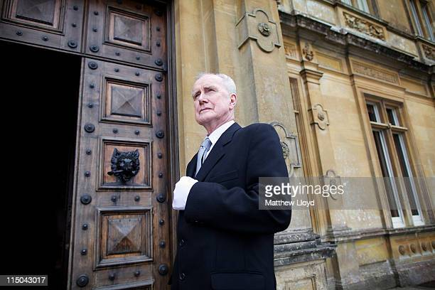 Colin the butler poses outside Highclere Castle on March 15 2011 in Newbury England Highclere Castle has been the ancestral home of the Carnarvon...