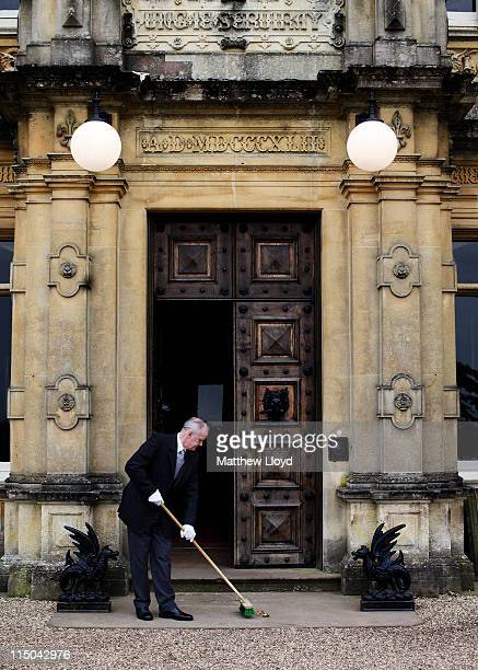 Colin the butler sweeps up outside Highclere Castle on March 15, 2011 in Newbury, England. Highclere Castle has been the ancestral home of the...