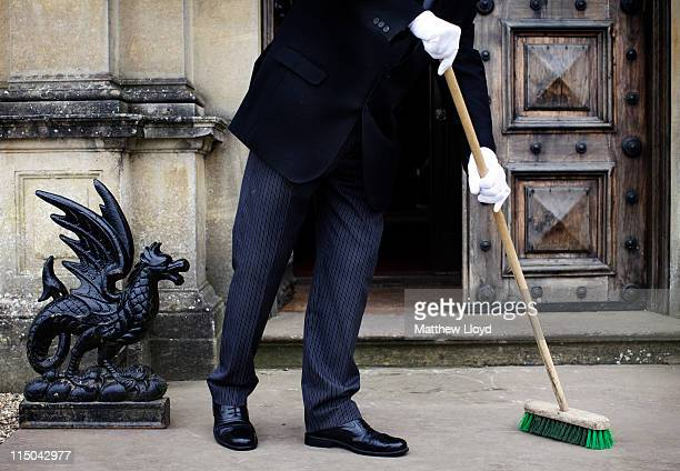 Colin the butler sweeps up outside Highclere Castle on March 15 2011 in Newbury England Highclere Castle has been the ancestral home of the Carnarvon...