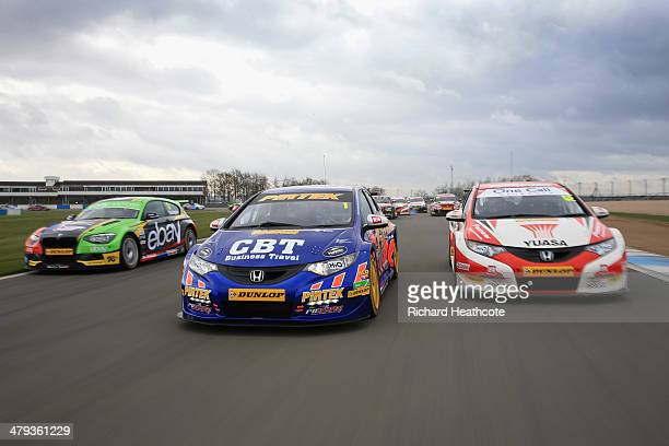 Colin Turkington in the eBay Motors BMW 125i Msport Andrew Jordan in the Pirtek Racing Honda Civic and Gordon Shedden in the Honda Yuasa Racing Civic...