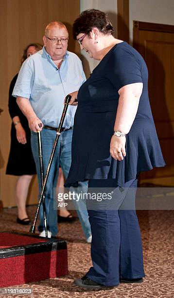 Colin Weir and his wife Chris arrive to address a press conference in Falkirk Scotland on July 15 after winning a record GBP161m in the EuroMillions...