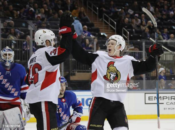 Colin White and Brady Tkachuk of the Ottawa Senators celebrate a third period goal by Brian Gibbons against the New York Rangers at Madison Square...