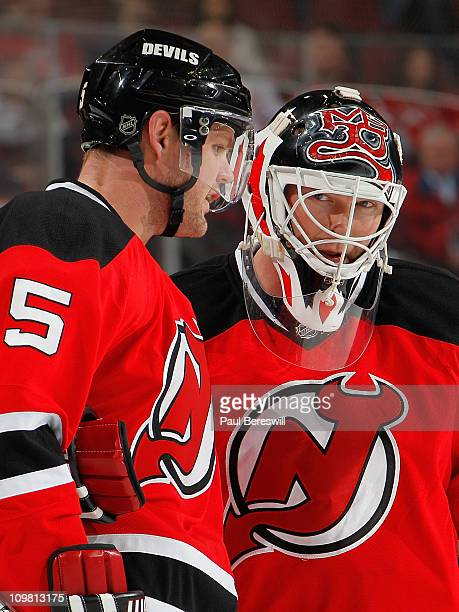 Colin White and Martin Brodeur of the New Jersey Devils talk during an NHL hockey game against the Tampa Bay Lightning at the Prudential Center on...