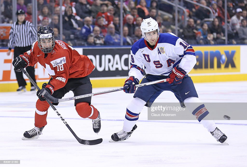 Colin White #18 of Team USA skates against Nico Hischier #18 of Team Switzerland during a QuarterFinal game at the 2017 IIHF World Junior Hockey Championships at Air Canada Centre on January 2, 2017 in Toronto, Ontario, Canada. Russia defeated Denmark 4-0.