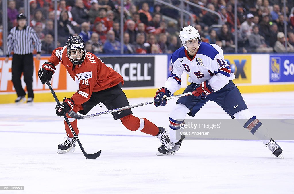 Colin White #18 of Team USA skates against Nico Hischier #18 of Team Switzerland during a QuarterFinal game at the 2017 IIHF World Junior Hockey Championships at Air Canada Centre on January 2, 2017 in Toronto, Ontario, Canada. Team USA defeated Team Switzerland 3-2.