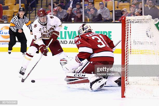 Colin White of the Boston College Eagles takes a shot against Merrick Madsen of the Harvard Crimson during the third period at TD Garden on February...