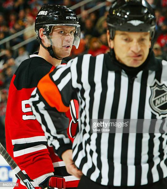 Colin White of the New Jersey Devils has words with referee Tom Peel after a penalty was called on Patrik Elias against the Buffalo Sabres at the...