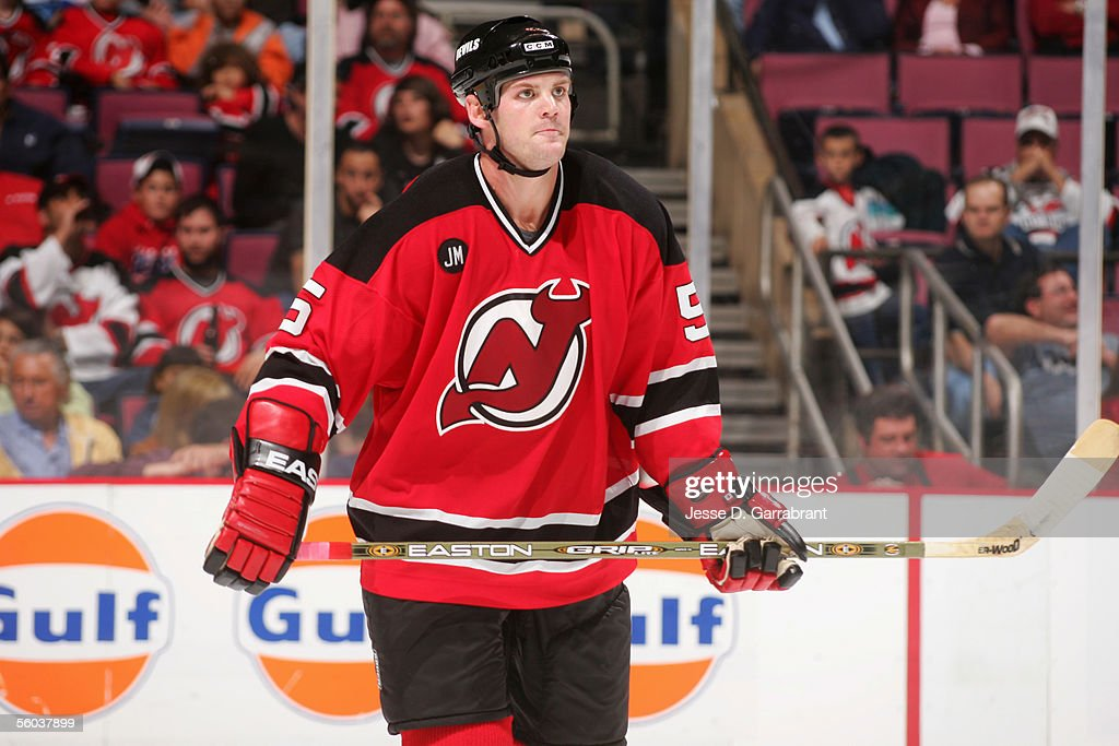 detailed look a69bd bd34a Colin White of the New Jersey Devils looks on during the ...