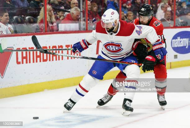 Colin White of the Ottawa Senators battles for puck control against Nate Thompson of the Montreal Canadiens in the first period at Canadian Tire...