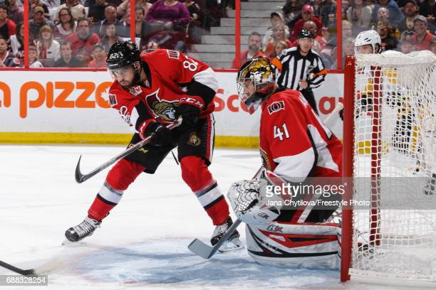 Colin White of the Ottawa Senators clears the puck from in front of teammate Craig Anderson in a game against the Pittsburgh Penguins in Game Six of...