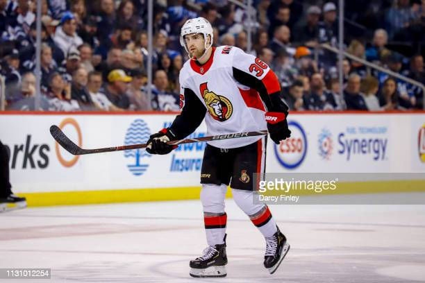 Colin White of the Ottawa Senators keeps an eye on the play during second period action against the Winnipeg Jets at the Bell MTS Place on February...