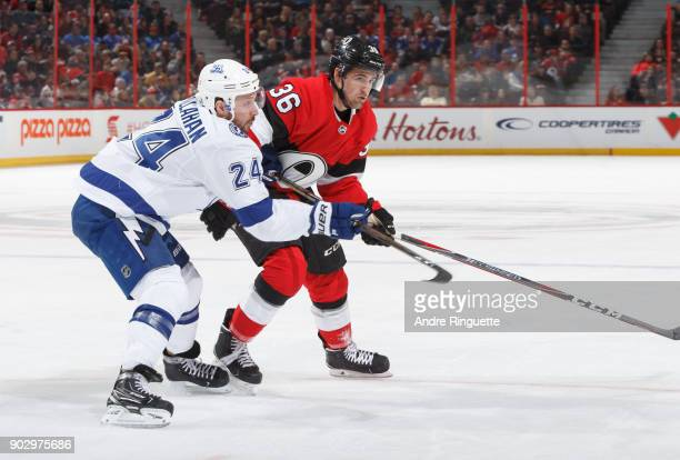 Colin White of the Ottawa Senators skates against Ryan Callahan of the Tampa Bay Lightning at Canadian Tire Centre on January 6 2018 in Ottawa...