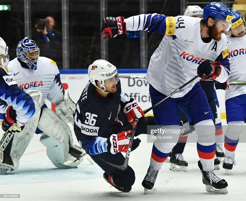 Colin White of the United States (L) falls behind South Korea's Alex Plante during the group B match the United States vs South Korea of the 2018 IIHF Ice Hockey World Championship at the Jyske Bank Boxen in Herning, Denmark, on May 11, 2018.
