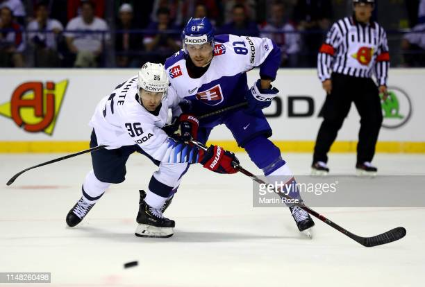 Colin White of United States challenges Erik Cernak of Slovakia during the 2019 IIHF Ice Hockey World Championship Slovakia group A game between...