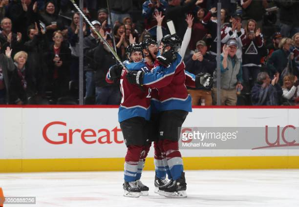 Colin Wilson Alexander Kerfoot and Erik Johnson of the Colorado Avalanche celebrate a goal against the Philadelphia Flyers at the Pepsi Center on...