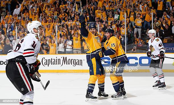 Colin Wilson and Craig Smith of the Nashville Predators celebrate goal against the Chicago Blackhawks in first period of Game One of the Western...