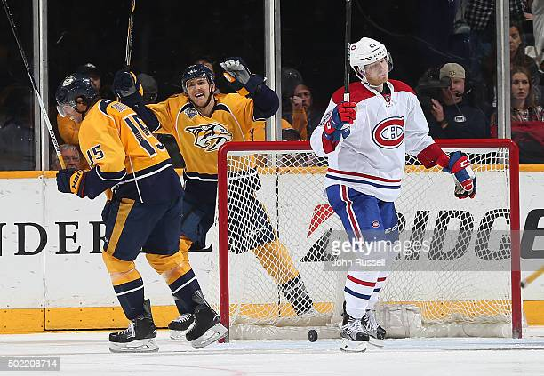 Colin Wilson and Craig Smith of the Nashville Predators celebrates a goal against Lars Eller of the Montreal Canadiens during an NHL game at...