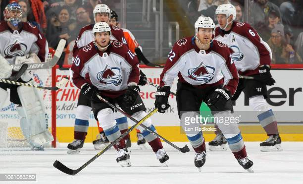 Colin Wilson and Sven Andrighetto of the Colorado Avalanche skate with teammates against the Philadelphia Flyers on October 22 2018 at the Wells...