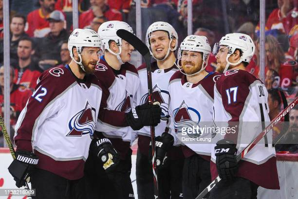 Colin Wilson of the Colorado Avalanche celebrates with his teammates after scoring against the Calgary Flames in Game Five of the Western Conference...