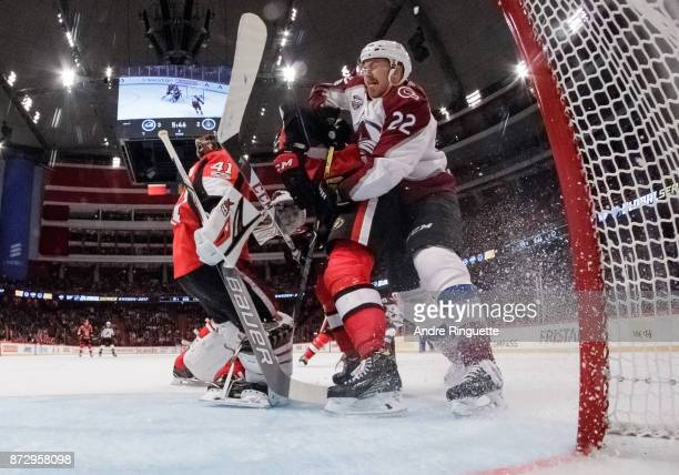 Colin Wilson of the Colorado Avalanche collides with Ryan Dzingel of the Ottawa Senators behind Craig Anderson at Ericsson Globe on November 11 2017...