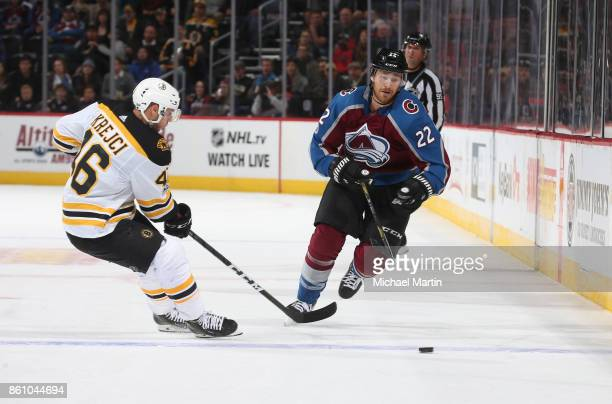 Colin Wilson of the Colorado Avalanche skates against Torey Krug of the Boston Bruins at the Pepsi Center on October 11 2017 in Denver Colorado The...