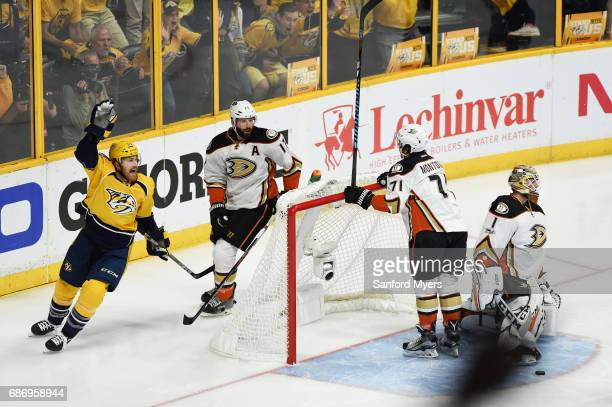 Colin Wilson of the Nashville Predators celebrates a goal by Austin Watson against Brandon Montour of the Anaheim Ducks during the first period in...