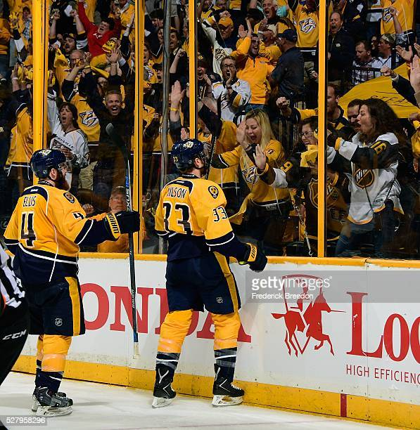 Colin Wilson of the Nashville Predators celebrates in front of fans after scoring a goal against the San Jose Sharks during the third period of Game...