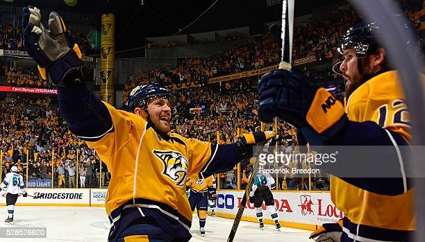 Colin Wilson of the Nashville Predators congratulates teammate Mike Fisher on scoring a goal against of the San Jose Sharks during the first period...