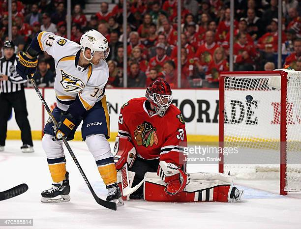 Colin Wilson of the Nashville Predators scores a goal on a deflection against Scott Darling of the Chicago Blackhawks in Game Four of the Western...
