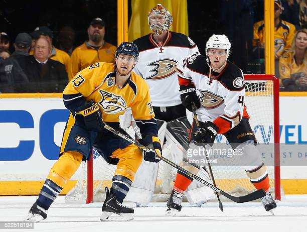 Colin Wilson of the Nashville Predators skates against Cam Fowler and Frederik Andersen of the Anaheim Ducks in Game Three of the Western Conference...