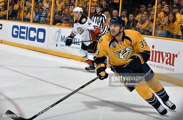Colin Wilson of the Nashville Predators skates against Cam Fowler of the Anaheim Ducks during the first period in Game Three of the Western...
