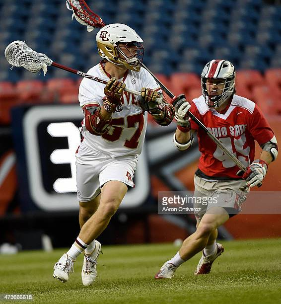Colin Woolford of the Denver Pioneers controls the ball as Brendan Barger of the Ohio State Buckeyes defends during the second half of Denver's 15-13...